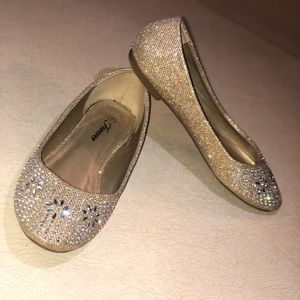 Gold flats with silver diamonds.